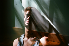 film photograph portrait young man  shadow chiaroscuro sunlight double exposure trippy geometry