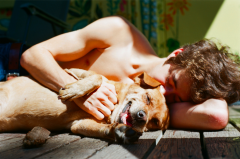 film photography portrait lying down summer sun dog ridgeback beagle hapa young man boy