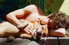 film photography portrait lying down summer sun dog ridgeback beagle hapa young man boy