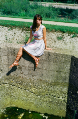film photograph portrait young woman girl cosplay companion cube joliet iron works wall sitting gladiator sandals
