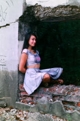 film photograph portrait young woman girl cosplay companion cube urbex crumbling debris ruinporn cute