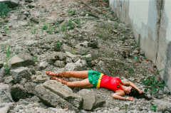 film photograph portrait young woman girl cosplay robin costume fallen lying dead rubble stones