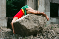 film photograph portrait young woman girl cosplay rubble urbex rock stone robin costume fallen lying mask