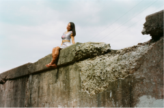 film photograph portrait young woman girl cosplay urbex wall sitting companion cube