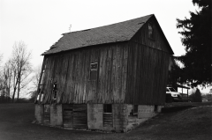 film photograph barn leaning collapsing countryside