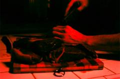 film photograph meat cutting steak raw board hands knife kitchen