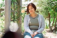 film photograph portrait young woman girl sitting bench rose white cream botanic garden cardigan hapa