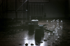 film photograph plastic bottles thread spools wooden floor art
