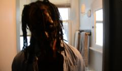 portrait silhouette bathroom african american man dreadlocks