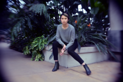 digital photograph portrait model plants conservatory hothouse leaves girl young woman sitting asian sweater short fashion hair pixie cut