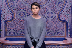 digital photograph portrait model fountain arabic middle eastern tiles girl young fashion woman sitting asian sweater short hair pixie cut