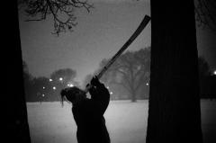 winter snow man playing didgeridoo park trees twilight shadow chiaroscuro dreadlocks