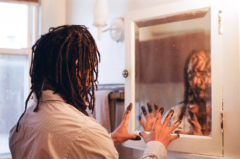 portrait african american man dreadlocks suit face paint charcoal no slaves reaching hands