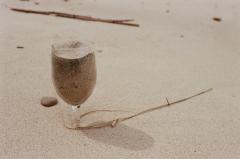 sand beach wine glass buried still life