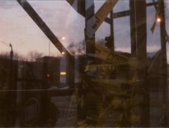 film photography lomography double exposure construction tape caution yellow plastic wrapped piping scaffolding structure dreamy surreal