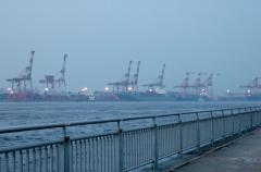 photograph of a misty scene at the docks blur perspective water dock machinery lights mist