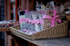 photograph of plastic boxes of lotus root slices for sale tied in pink ribbons asian asia snacks street food woven basket composition