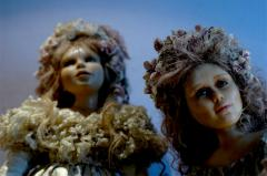 photograph of two dolls flowers creepy lighting blue dreamy gazing strange vintage china