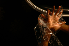 digital photograph dark light chiaroscuro shadows streak blur creepy black surreal bizarre saran wrap plastic wrapped hands fingers spread SM bondage games kinky play